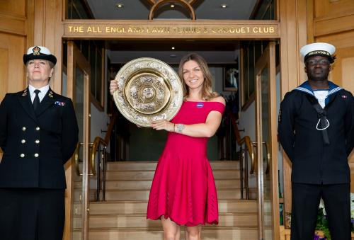 Simona Halep (ROU) poses with the Venus Rosewater Dish on Centre Court after winning the Ladies' Singles (3)