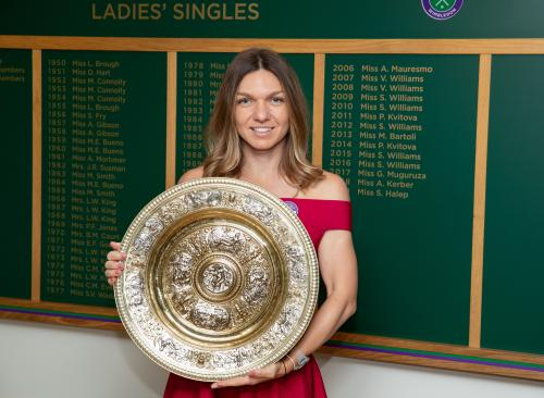 Simona Halep (ROU) poses with the Venus Rosewater Dish on Centre Court after winning the Ladies' Singles (5)