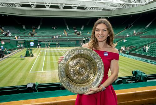 Simona Halep (ROU) poses with the Venus Rosewater Dish on Centre Court after winning the Ladies' Singles (1)