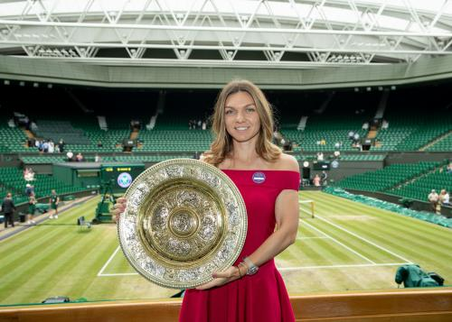 Simona Halep (ROU) poses with the Venus Rosewater Dish on Centre Court after winning the Ladies' Singles (4)
