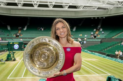 Simona Halep (ROU) poses with the Venus Rosewater Dish on Centre Court after winning the Ladies' Singles (8)