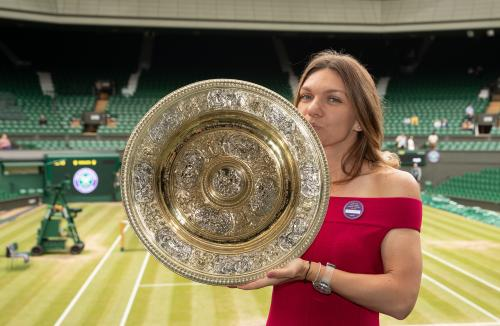 Simona Halep (ROU) poses with the Venus Rosewater Dish on Centre Court after winning the Ladies' Singles (6)